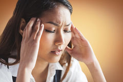 Nervous businesswoman holding her head Stock Photos