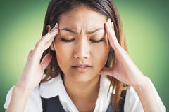 Nervous businesswoman holding her head Royalty Free Stock Photography
