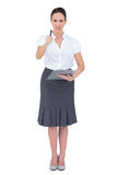 Nervous businesswoman pointing at camera Stock Photography