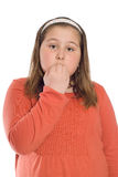 Nervous Child. A nervous child chewing her fingernails, isolated against a white background stock photos