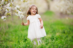 Nervous child girl in blossom garden Stock Image