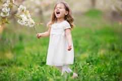 Nervous child girl in blossom garden Royalty Free Stock Image