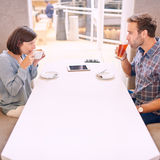 Nervous couple taking a sip on their first date Royalty Free Stock Image