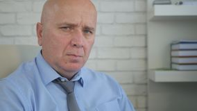 Nervous and Disappointed Businessman Looking to Camera Irritated royalty free stock photography
