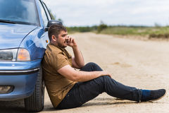 Nervous driver calls to the help desk by phone Stock Photos