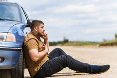 Nervous driver calls to the help desk by phone Stock Image
