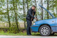 Nervous driver calls to the help desk by phone Royalty Free Stock Images