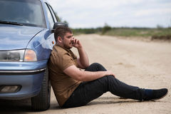Nervous driver calls to the help desk by phone Royalty Free Stock Image