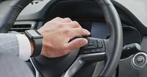 Nervous driver pushing horn on leather steering wheel in car