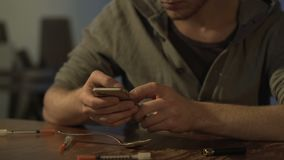 Nervous drug addict texting on smartphone to dealer, looking for heroin dose. Stock footage stock video footage
