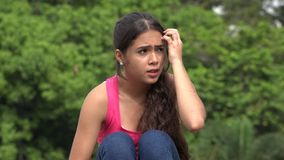 Nervous fearful female teen. A young female hispanic teen stock video