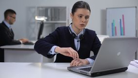 Nervous female call manager taking off headset and closing laptop, hard day stock footage