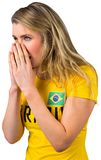 Nervous football fan in brasil tshirt Stock Image
