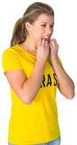 Nervous football fan in brasil tshirt Royalty Free Stock Photography