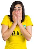 Nervous football fan in brasil tshirt Stock Photos