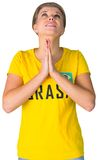 Nervous football fan in brasil tshirt Stock Photo