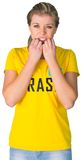 Nervous football fan in brasil tshirt Royalty Free Stock Photo