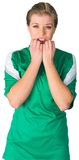 Nervous football fan in green Royalty Free Stock Images