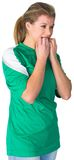 Nervous football fan in green Stock Images