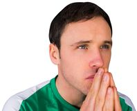 Nervous football fan in green Stock Photos