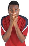 Nervous football fan looking ahead Royalty Free Stock Image