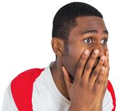 Nervous football fan looking ahead Stock Photography