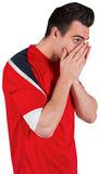 Nervous football fan looking ahead Royalty Free Stock Photos