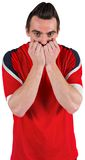 Nervous football fan looking ahead Royalty Free Stock Photography