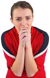 Nervous football fan in red Royalty Free Stock Photos