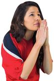 Nervous football fan in red. On white background Stock Image