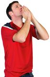 Nervous football fan in red Stock Photo