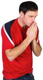 Nervous football fan in red Royalty Free Stock Image