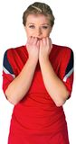 Nervous football fan in red Stock Images