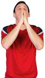 Nervous football fan in red Stock Photos