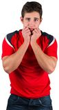 Nervous football fan in red Royalty Free Stock Photography