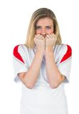 Nervous football fan in white Stock Photo