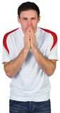 Nervous football fan in white Stock Images