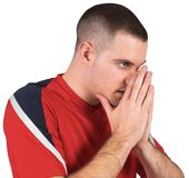 Nervous football player looking ahead. On white background Stock Photo