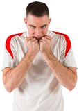 Nervous football player looking at camera Royalty Free Stock Images