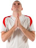 Nervous football player looking up. On white background Royalty Free Stock Image