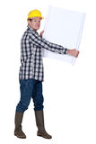 Nervous foreman holding plans Royalty Free Stock Photos