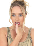 Nervous Frightened Young Woman Biting Thumb Nail Royalty Free Stock Photos