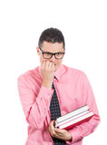 A nervous geek biting nails Royalty Free Stock Images