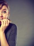 Nervous girl biting nails. stock images