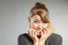 Nervous girl biting nails. Stock Images