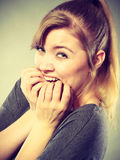 Nervous girl biting nails. Royalty Free Stock Images