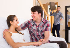 Nervous husband watching flirting spouse Royalty Free Stock Photography