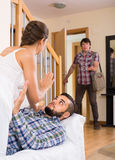 Nervous husband watching flirting spouse Royalty Free Stock Photo