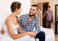Nervous husband watching flirting spouse Royalty Free Stock Images