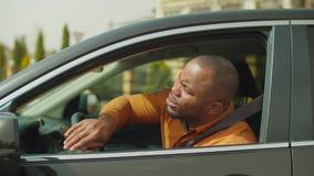 Nervous male driver pressing car horn in traffic jam